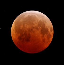 The moon looks red during an eclipse, as shown in this photo taken during the total lunar eclipse Dec. 21, 2010. (photo by Robert Grover)